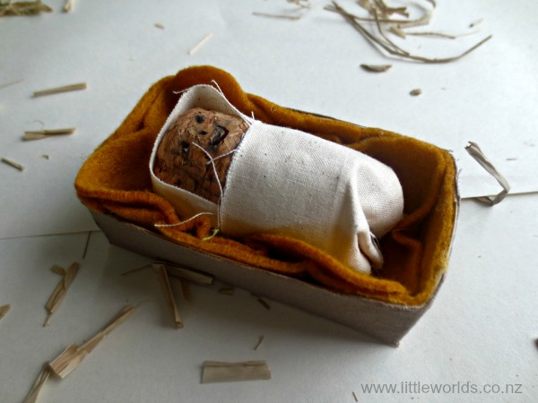 Image Baby Jesus and his manger bed